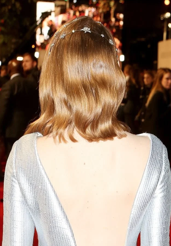 emma Stone wearing Star Kissed